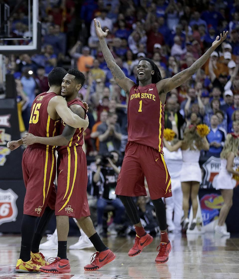 Iowa State players celebrate a basket during the second half of an NCAA college basketball game against Kansas in the finals of the Big 12 Conference tournament Saturday, March 14, 2015, in Kansas City, Mo. (AP Photo/Charlie Riedel)