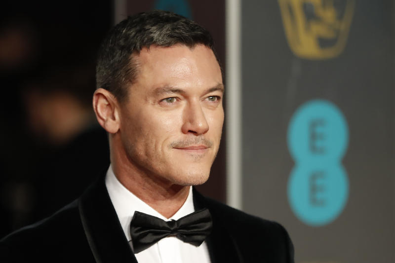 Luke Evans poses on the red carpet upon arrival at the BAFTA Film Awards at the Royal Albert Hall on February 10, 2019. (Photo by Tolga Akmen/AFP via Getty Images)