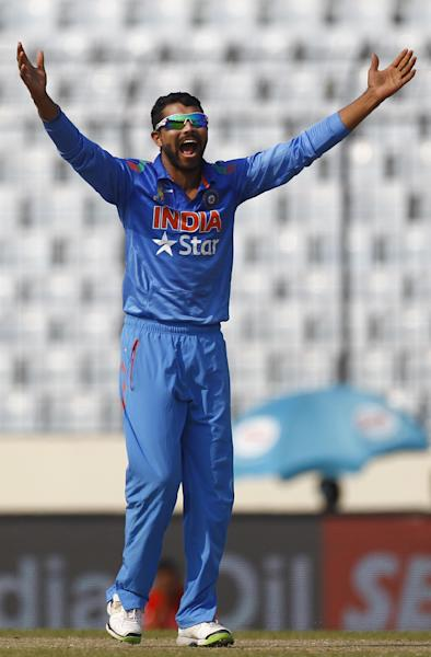 Indian cricketer Ravindra Jadeja appeals successfully for the dismissal of Afghan cricket player Rahmat Shah during the Asia Cup one-day international cricket tournament in Dhaka, Bangladesh, Wednesday, March 5, 2014. (AP Photo/A.M. Ahad)
