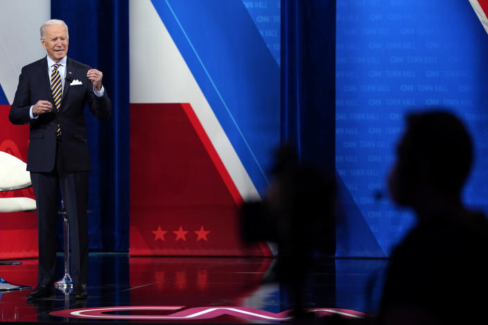President Joe Biden answers questions during a televised town hall event at Pabst Theater, Tuesday, Feb. 16, 2021, in Milwaukee. (AP Photo/Evan Vucci)