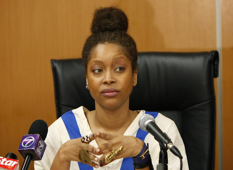 U.S. singer Erykah Badu listens to a question during a press conference in Kuala Lumpur, Malaysia, Wednesday, Feb. 29, 2012. Muslim-majority Malaysia on Tuesday banned a planned concert by Badu after a photograph appeared showing the Grammy-winning singer with the Arabic word for Allah written on her body. (AP Photo/Lai Seng Sin)