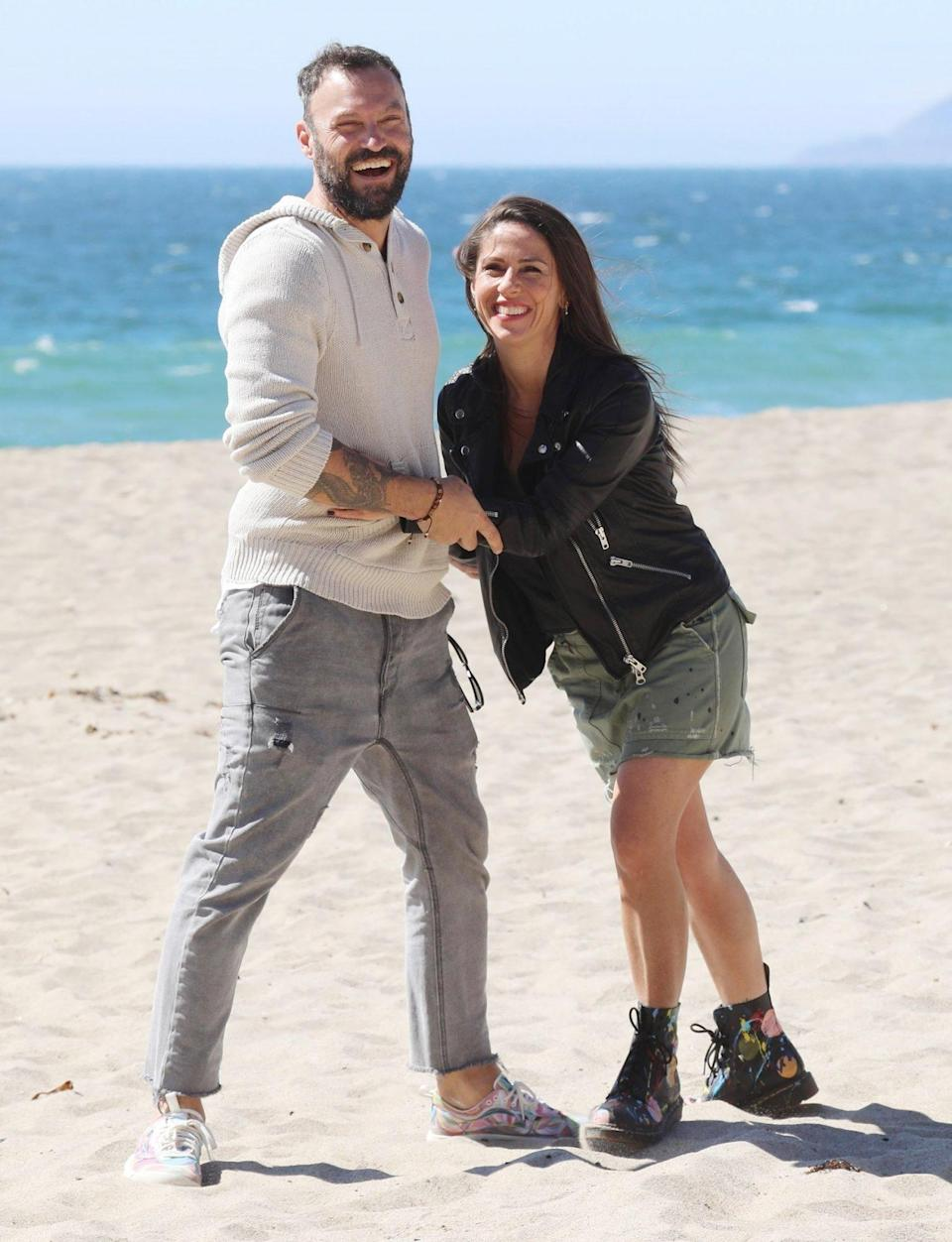 <p>Longtime pals Soleil Moon Frye and Brian Austin Green goof around at the beach on Monday in Malibu.</p>