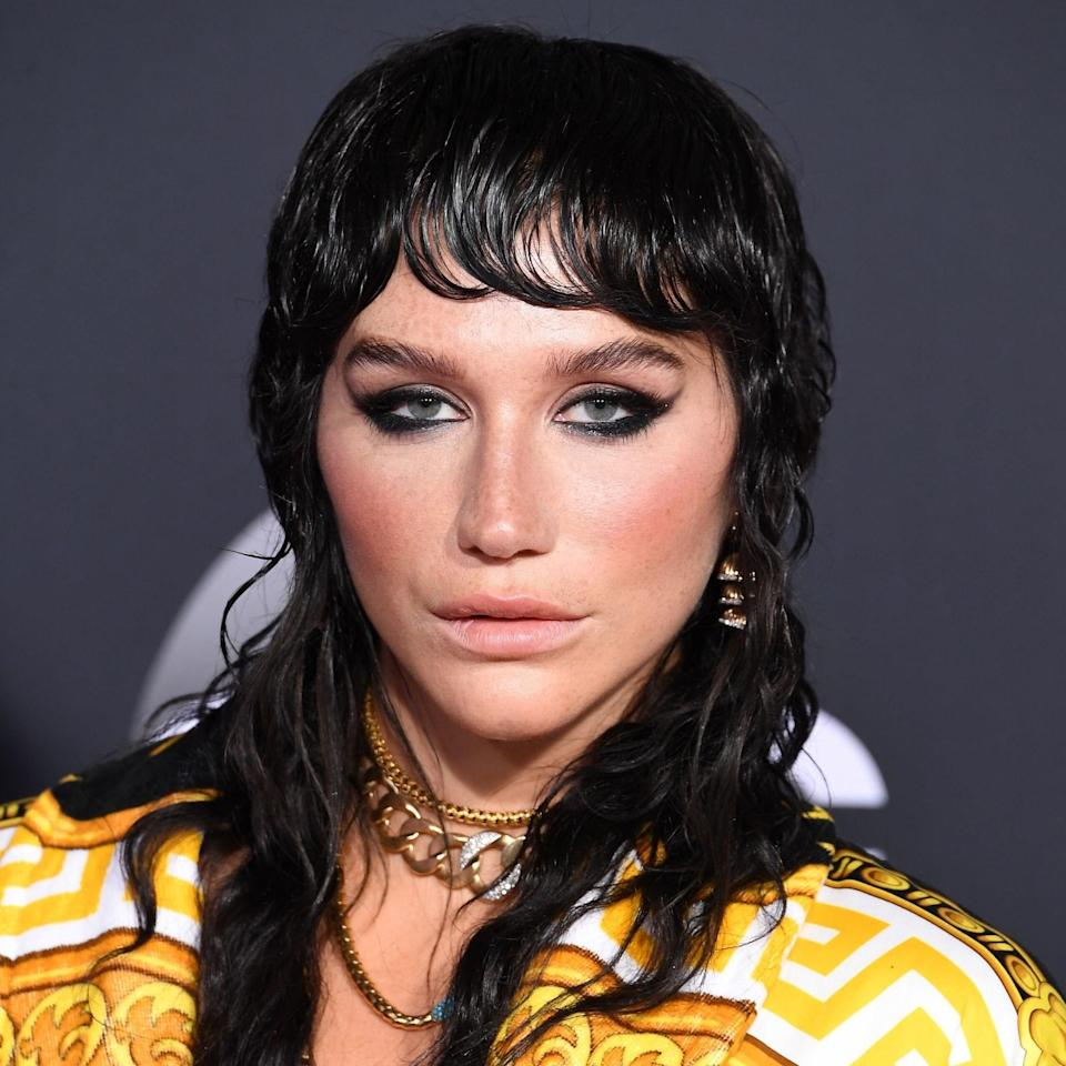 """The '70s are calling and celebrities are answering — and will continue to do so next year. """"The <a href=""""https://www.allure.com/gallery/shag-haircut-ideas-trend?mbid=synd_yahoo_rss"""" rel=""""nofollow noopener"""" target=""""_blank"""" data-ylk=""""slk:shag"""" class=""""link rapid-noclick-resp"""">shag</a> is a mainstay in style. In 2020, we are seeing an updated version that lends itself to modern styling,"""" says hairstylist and co-founder of Spoke & Weal Salons, <a href=""""https://www.instagram.com/jonreymanhair/?hl=en"""" rel=""""nofollow noopener"""" target=""""_blank"""" data-ylk=""""slk:Jon Reyman"""" class=""""link rapid-noclick-resp"""">Jon Reyman</a>. """"It's sexy, strong, and flattering. Try a shag with or without a strong fringe that is cut away into long or short hair, following a hybrid of the mullet and the shag. This look works for curly hair, straight hair, long, mid-length, and even shorter hair."""" <a href=""""https://www.allure.com/story/kesha-rose-beauty-makeup-interview?mbid=synd_yahoo_rss"""" rel=""""nofollow noopener"""" target=""""_blank"""" data-ylk=""""slk:Kesha"""" class=""""link rapid-noclick-resp"""">Kesha</a> wore the look with wet styling to the AMAs this year."""