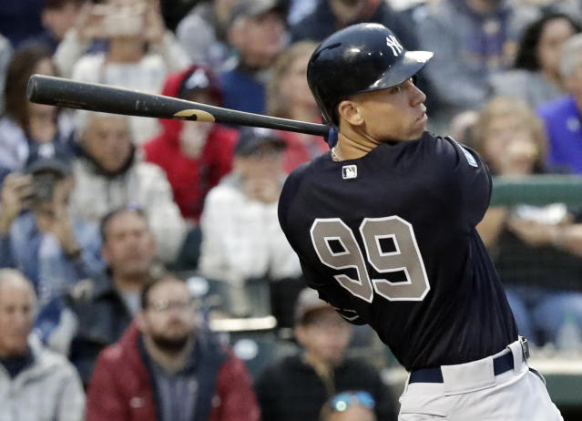 New York Yankees' Aaron Judge hits a triple to drive in two runs in fifth inning of a spring baseball exhibition game against the Atlanta Braves, Monday, March 18, 2019, in Kissimmee, Fla. (AP Photo/John Raoux)