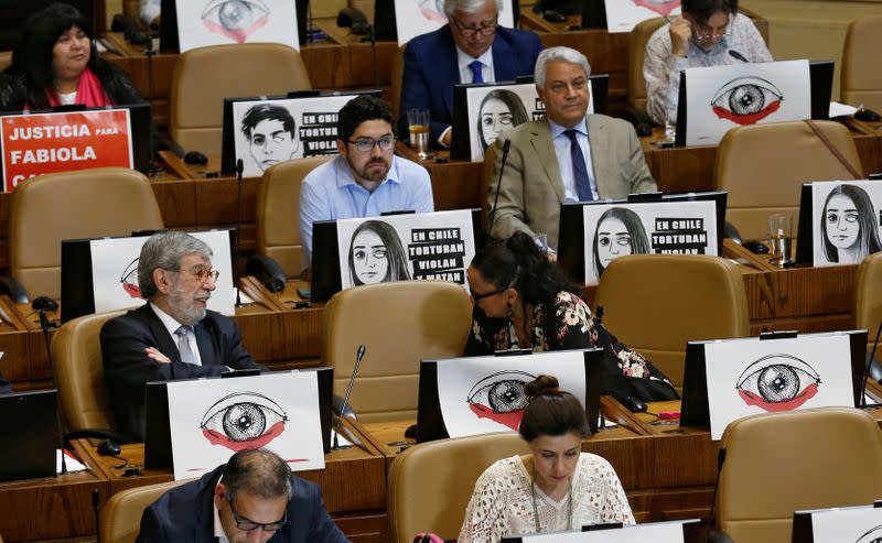 Lawmakers of the opposition debate and vote on an impeachment motion against Chile's President Sebastian Pinera, at a session at the congress in Valparaiso