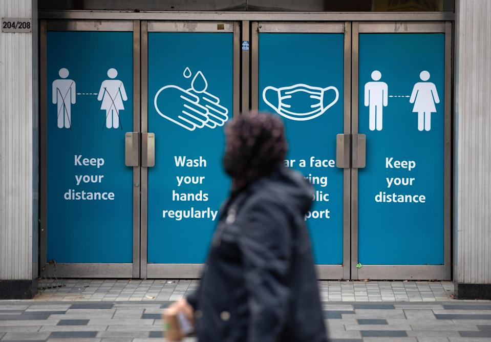 Social distancing signs in Slough High Street (Andrew Matthews) (PA Archive)