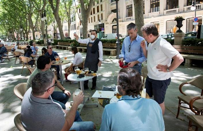 Many Spaniards enjoyed new freedoms on outdoor terraces after weeks of stay-home orders (AFP Photo/JAIME REINA)