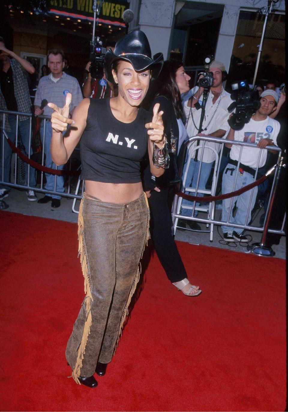 <p>To show her support for her husband Will Smith's <em>Wild Wild West</em> film, Jada showed up to the premiere decked out in fringed leather pants and a cowboy hat. Literally a *wild* outfit, amirite?!</p>