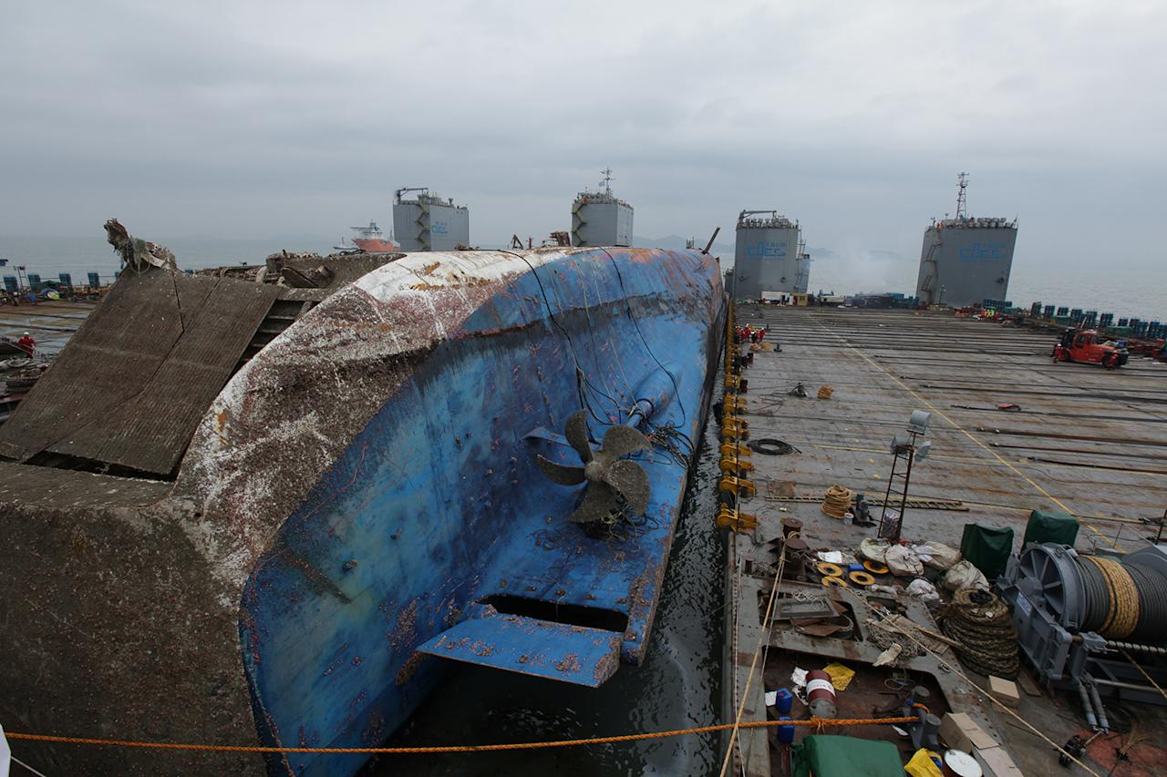 <p>The sunken ferry Sewol sits on a semi-submersible ship during its salvage operations at the sea off Jindo, South Korea, in this handout picture provided by the Ministry of Oceans and Fisheries and released by News1 on March 25, 2017. (Photo: The Ministry of Oceans and Fisheries/News1/Reuters) </p>