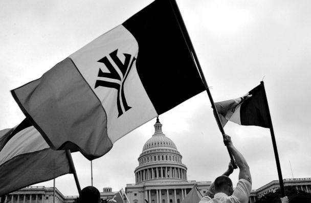 PHOTO: In this Aug. 24, 2004, file photo, National Alliance members march on the yard of the Capitol Building along side other racists groups, like skinheads and klansmen during a protest in Washington, DC. (David S. Holloway/Getty Images, FILE)