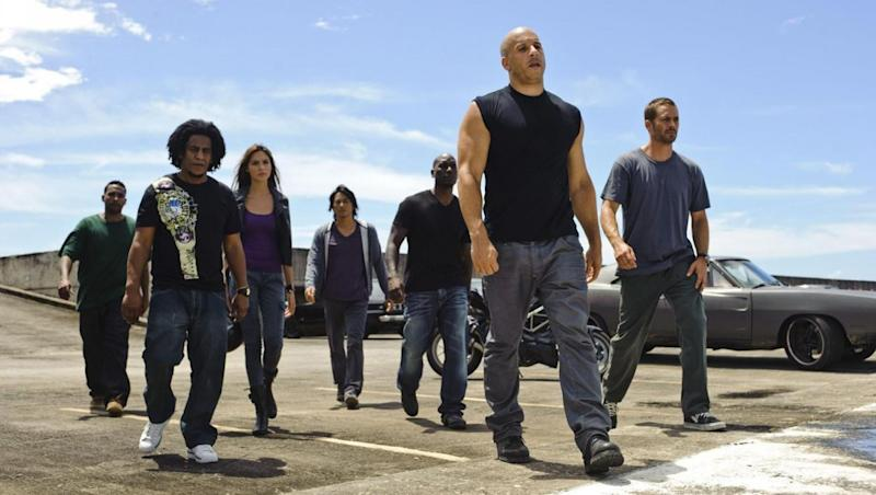'Fast and Furious 5' (2011) L-R Don Omar, Tego Calderon, Gal Gadot, Sung Kang, Tyrese Gibson, Vin Diesel, Paul Walker (Credit: Universal Pictures)