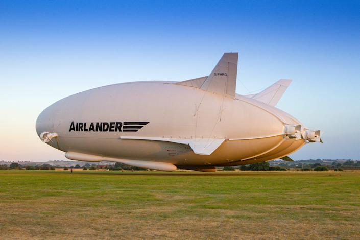 The Airlander 10 over a field