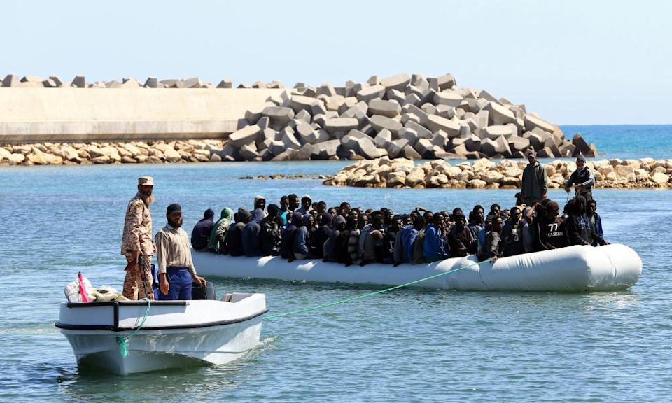 A boat is brought back to Libya in May 2017 by coastguard officials rescued who rescued those on board at sea.