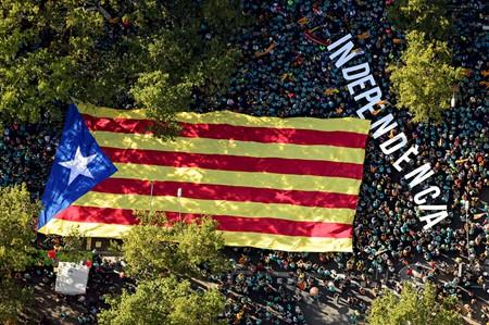 "An aerial view shows people holding a giant ""Estelada"" (Catalan separatist flag) at a rally during Catalonia's national day 'La Diada' in Barcelona"