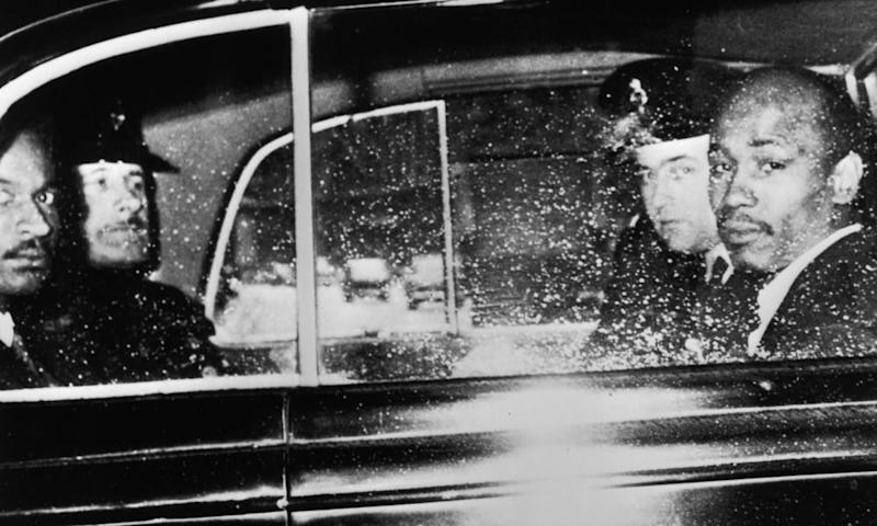 Lucky Gordon, right, and Johnny Edgecombe, both witnesses in the Profumo affair, leave the Treasury with a police escort in July 1963.