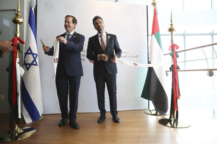 Israel's President Isaac Herzog, left, cuts a ribbon with United Arab Emirates ambassador to Israel Mohamed Al Khaja during the opening ceremony for the new UAE Embassy in Tel Aviv, Israel, Wednesday, July 14, 2021. (AP Photo/Ariel Schalit)