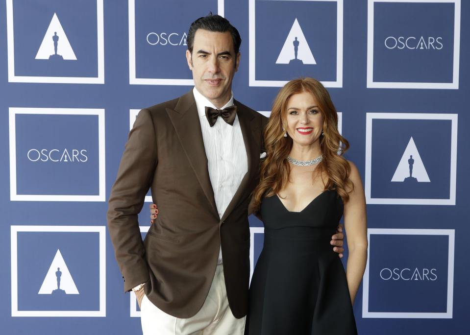 Sacha Baron Cohen and Isla Fisher pose for a photo during a screening of the Oscars on Monday April 26, 2021 in Sydney, Australia. (AP Photo/Rick Rycroft, Pool)
