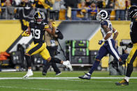 Pittsburgh Steelers free safety Minkah Fitzpatrick (39) heads for the end zone for a touchdown after intercepting a pass from Los Angeles Rams quarterback Jared Goff (not shown) during the first half of an NFL football game in Pittsburgh, Sunday, Nov. 10, 2019. (AP Photo/Keith Srakocic)