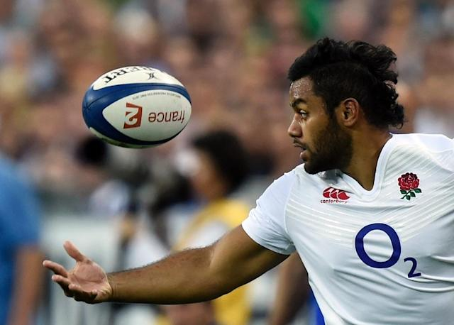 England's number 8 Billy Vunipola looks at the ball during a Rugby World Cup warm up match between France and England at the Stade de France in Saint-Denis, north of Paris, on August 22, 2015 (AFP Photo/MIGUEL MEDINA)