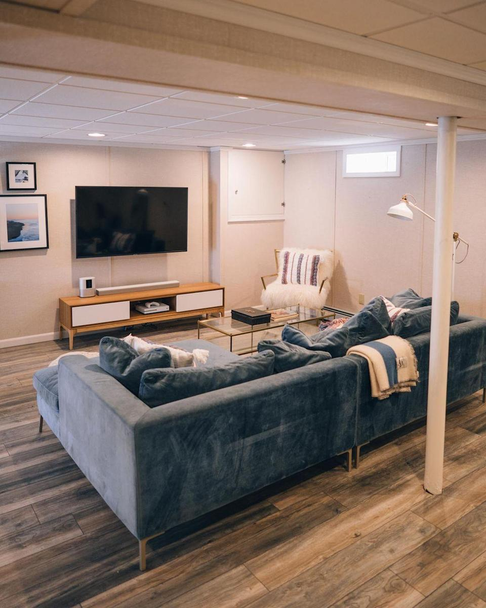 "<p>Creamy oak flooring can elevate any space, and this laid-back, modern basement is no exception! Bonus: This laminate flooring is super pet-friendly so you can feel good about cuddling up with your furry companions. </p><p><strong>See more at <a href=""https://www.jessannkirby.com/basement-makeover-renovation-reveal/"" rel=""nofollow noopener"" target=""_blank"" data-ylk=""slk:Jess Ann Kirby"" class=""link rapid-noclick-resp"">Jess Ann Kirby</a>.</strong></p><p><a class=""link rapid-noclick-resp"" href=""https://go.redirectingat.com?id=74968X1596630&url=https%3A%2F%2Fwww.walmart.com%2Fip%2FBuilddirect-Shipyard-Oak-12mm-RL-X-7-5-Laminate-Flooring-18-42-sq-ft-per-box%2F977411547&sref=https%3A%2F%2Fwww.thepioneerwoman.com%2Fhome-lifestyle%2Fdecorating-ideas%2Fg34763691%2Fbasement-ideas%2F"" rel=""nofollow noopener"" target=""_blank"" data-ylk=""slk:SHOP OAK LAMINATE FLOORING"">SHOP OAK LAMINATE FLOORING</a></p>"