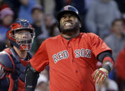 Boston Red Sox designated hitter David Ortiz grimaces after fouling the ball off his foot as Minnesota Twins catcher Chris Herrmann stands next to him during the fourth inning of a baseball game Wednesday, June 3, 2015, at Fenway Park in Boston. (AP Photo/Elise Amendola)
