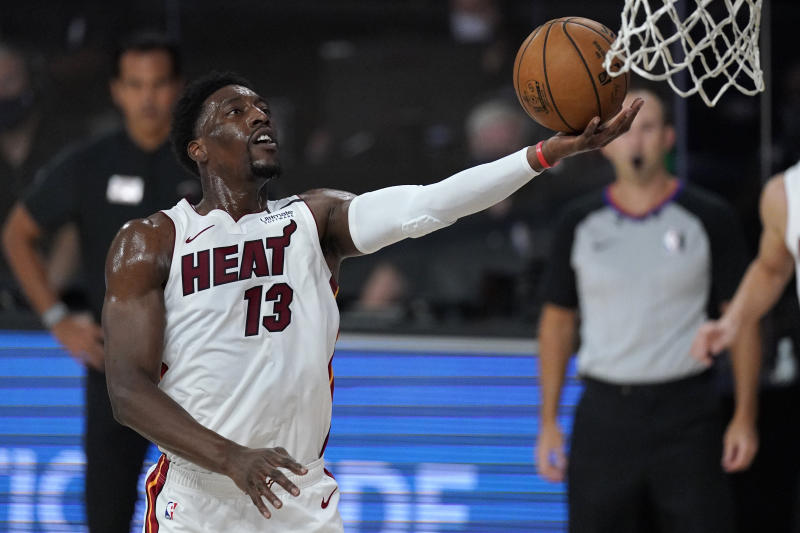 Miami Heat's Bam Adebayo (13) goes up for a layup during the first half of an NBA conference final playoff basketball game against the Boston Celtics on Tuesday, Sept. 15, 2020, in Lake Buena Vista, Fla. (AP Photo/Mark J. Terrill)