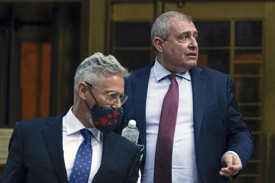 Lev Parnas, right, leaves the courthouse in New York, Tuesday, Oct. 12, 2021. A jury was selected for the trial of Parnas, a onetime associate of Rudy Giuliani who is accused along with a co-defendant of making illegal campaign contributions. (AP Photo/Seth Wenig)