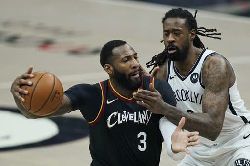 Cleveland Cavaliers' Andre Drummond (3) drives past Brooklyn Nets' DeAndre Jordan (6) during the first half of an NBA basketball game, Wednesday, Jan. 20, 2021, in Cleveland. (AP Photo/Tony Dejak)