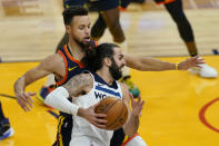 Minnesota Timberwolves guard Ricky Rubio, foreground, drives against Golden State Warriors guard Stephen Curry during the first half of an NBA basketball game in San Francisco, Wednesday, Jan. 27, 2021. (AP Photo/Jeff Chiu)