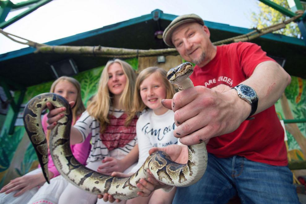 Pic by Laura Dale / Caters News (PICTURED: Dean Tweedy and his daughters, left to right, Paige, Sophie and Sarah, at their zoo in Wales (Picture: Caters)