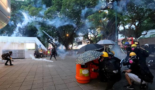 There were intense clashes between protesters and police near Tsim Sha Tsui Police Station on Sunday, as well as several other parts of Hong Kong. Photo: Felix Wong
