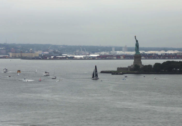 The Malizia II passes the Statue of Liberty with Swedish climate activist Greta Thunberg aboard, is escorted by a flotilla into New York Harbor at the conclusion of Thunberg's trans-Atlantic voyage, Wednesday, Aug. 28, 2019. The 16-year old Thunberg crossed the Atlantic aboard a zero-emissions sailboat to address the United Nations Climate Action Summit on Sept. 23. (AP Photo/Wong Maye-E)