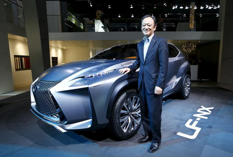 File photo of Fukuichi, executive vice president of Lexus, posing next to a Lexus LF-NX mid-size crossover concept during a media preview day at the Frankfurt Motor Show