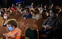 "The audience watching the reopening of ""Perfect Crime"" at Theater Center in New York, April 27"