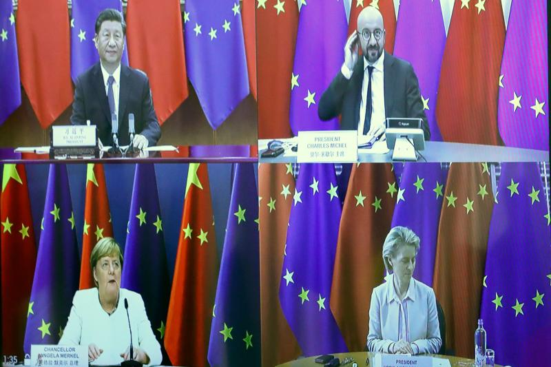 Chinese President Xi Jinping (top L), European Council President Charles Michel (top R), European Commission President Ursula von der Leyen (bottom R) and German Chancellor Angela Merkel (bottom L) are seen in split screen on a monitor during the EU-China summit on September 14, 2020, in Brussels. Photo: Yves Herman/AFP via Getty Images
