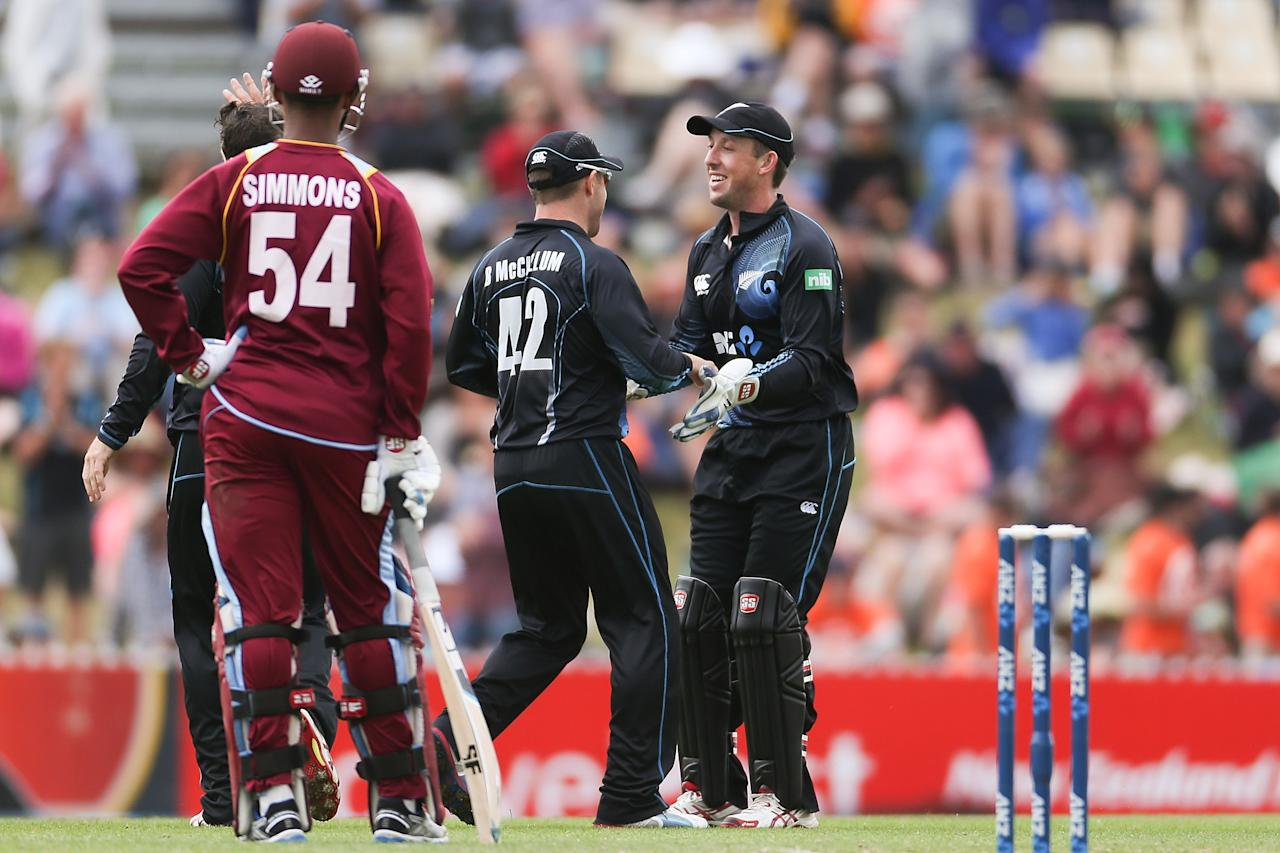 NELSON, NEW ZEALAND - JANUARY 04:  Brendon McCullum of New Zealand (C) celebrates a wicket with Luke Ronchi (R) during game four of the One Day International Series between New Zealand and the West Indies at Saxton Field on January 4, 2014 in Nelson, New Zealand.  (Photo by Martin Hunter/Getty Images)