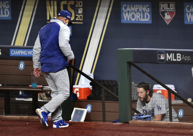 Clayton Kershaw sits in the dugout moments after being removed from the game in the sixth inning.