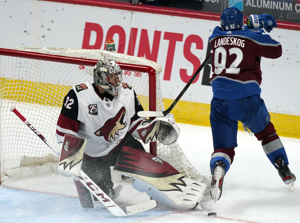 Arizona Coyotes goaltender Antti Raanta, left, makes a skate save of a shot by Colorado Avalanche left wing Gabriel Landeskog in the third period of an NHL hockey game Monday, March 8, 2021, in Denver. The Coyotes won 3-2. (AP Photo/David Zalubowski)