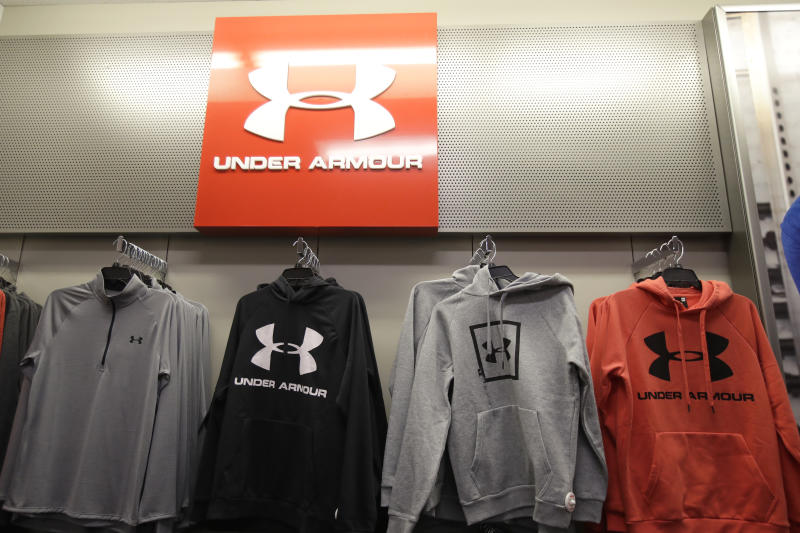 Under Armour clothes are displayed at a Kohl's store in Colma, Calif., Friday, Nov. 29, 2019. (AP Photo/Jeff Chiu)
