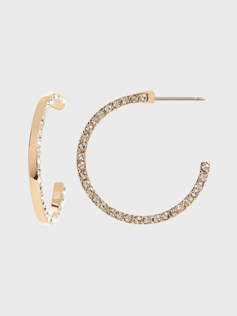 <p>Add a touch of sparkle with these <span>Pavé Detail Hoop Earrings</span> ($21, originally $42).</p>