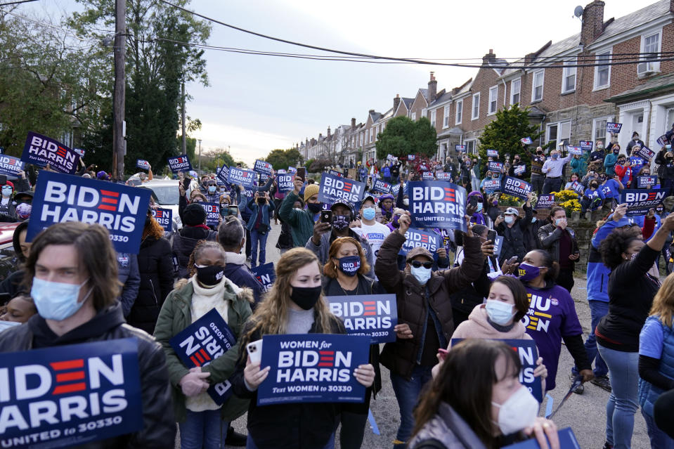 Supporters fill the street as Democratic presidential candidate former Vice President Joe Biden speaks during a stop in Philadelphia, Tuesday, Nov. 3, 2020. (AP Photo/Carolyn Kaster)