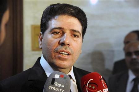 Syrian Prime Minister al-Halki talks to media in Damascus