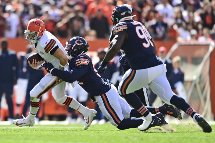 Chicago Bears outside linebacker Khalil Mack, second from left, sacks Cleveland Browns quarterback Baker Mayfield during the first half of an NFL football game, Sunday, Sept. 26, 2021, in Cleveland. (AP Photo/David Dermer)