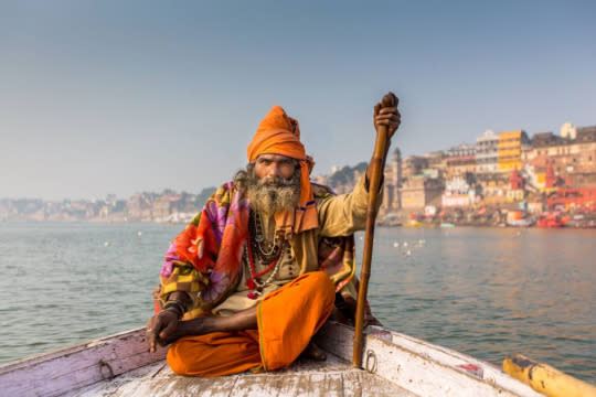 """<p>In <a href=""""http://travelbabbo.com/2015/12/ten-incredible-places-to-visit-in-india/"""">Varanasi, India</a> we asked a Sadhu (holy man) if he wanted a ride up the river on our boat. It brought the spirituality of the holy city a little closer for the magical 20-minute ride. <i>—Eric Stoen, <a href=""""http://travelbabbo.com/"""">Travel Babbo</a></i><br /></p>"""