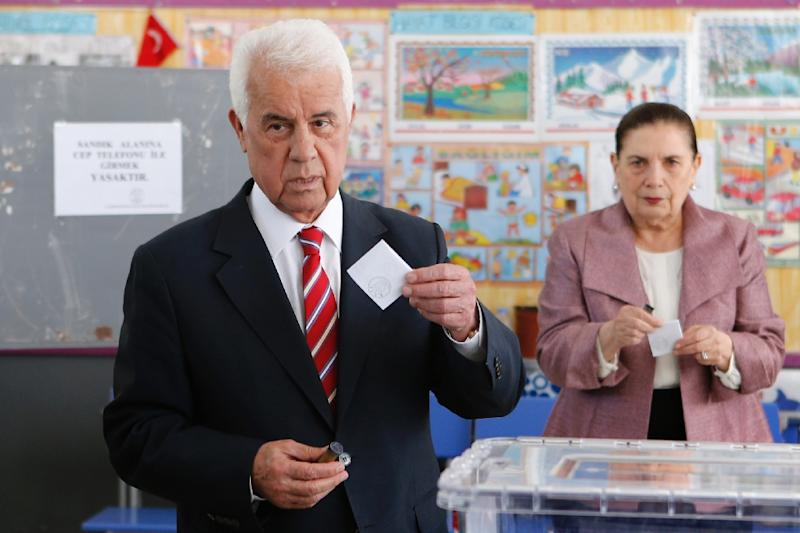 Turkish Cypriot President and candidate for the presidential election in the self-proclaimed Turkish Republic of Northern Cyprus (TRNC), Dervis Eroglu, casts his vote on April 26, 2015 at a polling station in Famagusta (AFP Photo/Florian Choblet)