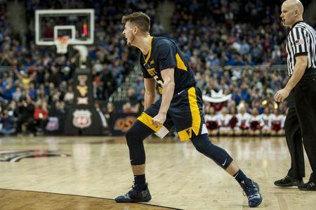 Mar 14, 2019; Kansas City, MO, USA; West Virginia Mountaineers guard Jordan McCabe (5) celebrates after scoring a basket against the Texas Tech Red Raiders during the first half of the quarterfinals of the Big 12 conference tournament at Sprint Center. Mandatory Credit: Amy Kontras-USA TODAY Sports