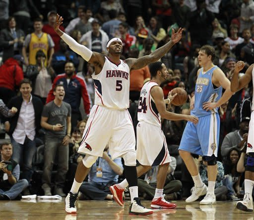 Atlanta Hawks small forward Josh Smith (5) reacts after scoring and being fouled in the final seconds of an NBA basketball game against the Denver Nuggets, Wednesday, Dec. 5, 2012, in ATlanta. Atlanta won 108-104. (AP Photo/John Bazemore)