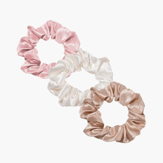 """<p><a class=""""link rapid-noclick-resp"""" href=""""https://thebigsilk.com/products/medium-silk-scrunchie"""" rel=""""nofollow noopener"""" target=""""_blank"""" data-ylk=""""slk:SHOP NOW"""">SHOP NOW</a></p><p>We've seen the scrunchie return in a huge way but these silk ones avoid the hair pulling we often experience with the originals. The non-slip silk keeps your ponytail sky high without damaging or breaking fragile hair. An ideal stocking filler if you ask us. </p>"""