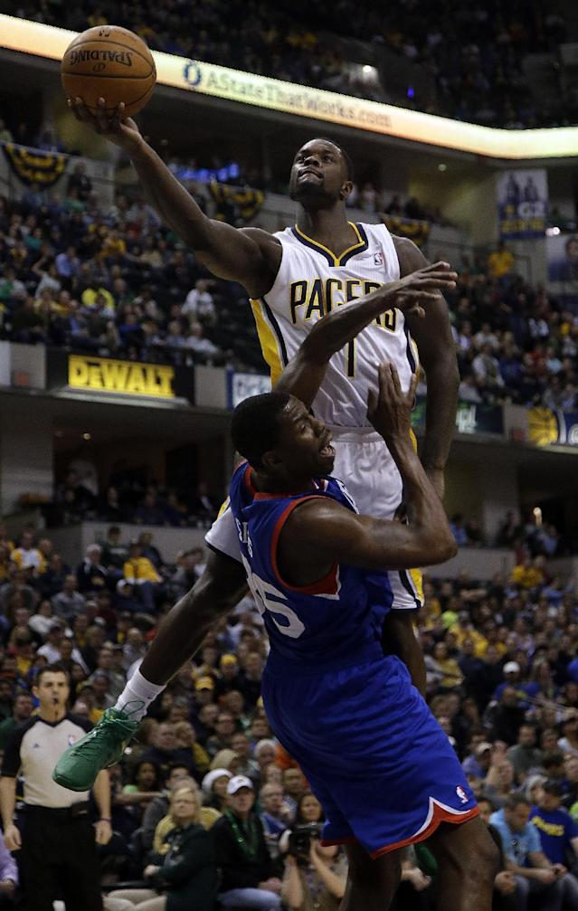 Indiana Pacers guard Lance Stephenson (1) commits an offensive foul against Philadelphia 76ers center Henry Sims (35) while shooting during the second half of an NBA basketball game in Indianapolis, Monday, March 17, 2014. The Pacers won 99-90. (AP Photo/AJ Mast)