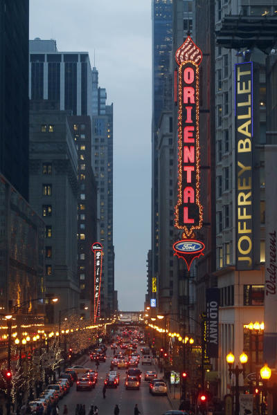 In this Nov. 19, 2012 photo, traffic passes through the theater district in downtown Chicago. The Windy City is letting its Broadway bling shine with the help of a little-known state tax credit. Two musicals destined for New York have chosen to preview in Chicago's theater district and take advantage of a unique Illinois tax break aimed at luring shows. And city theater officials recently said they're in talks with at least nine other productions interested in coming to the city. (AP Photo/Charles Rex Arbogast)